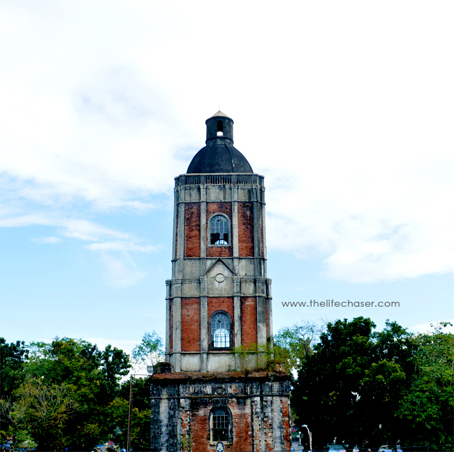 An old belfry across jaro Cathedral